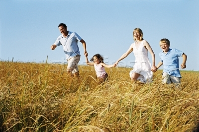 93329_stock-photo-family-running-outdoors-holding-hands-smiling